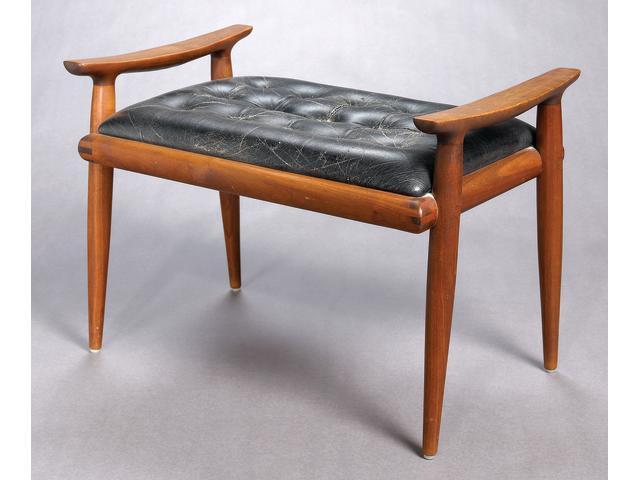 A Sam Maloof walnut and leather bench