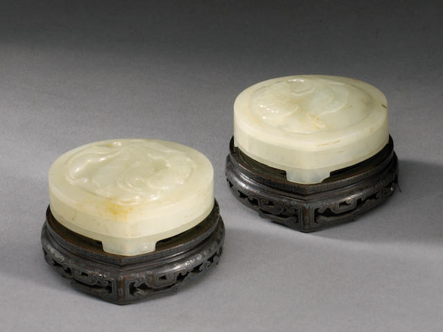 A pair of white jade two-sectioned covered boxes