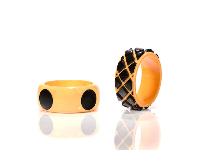 Two cream and black Bakelite bangle bracelets