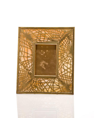 A Tiffany Studios Favrile glass and gilt bronze pine needle picture frame