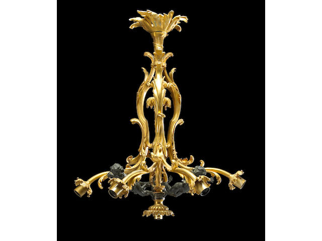 A Belle Epoque style patinated and gilt bronze seven light chandelier