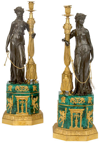 A pair of Empire style gilt and patinated bronze malachite mounted lamp standards