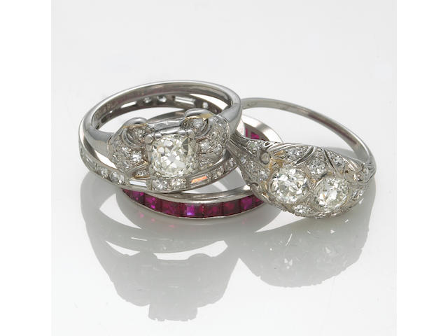A collection of four diamond and ruby rings