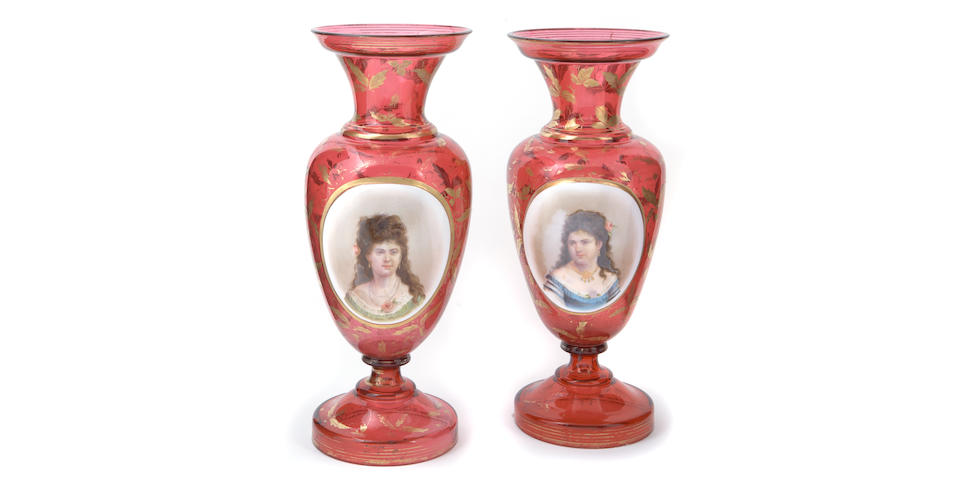 A pair of Bohemian ruby flashed baluster form glass portrait vases