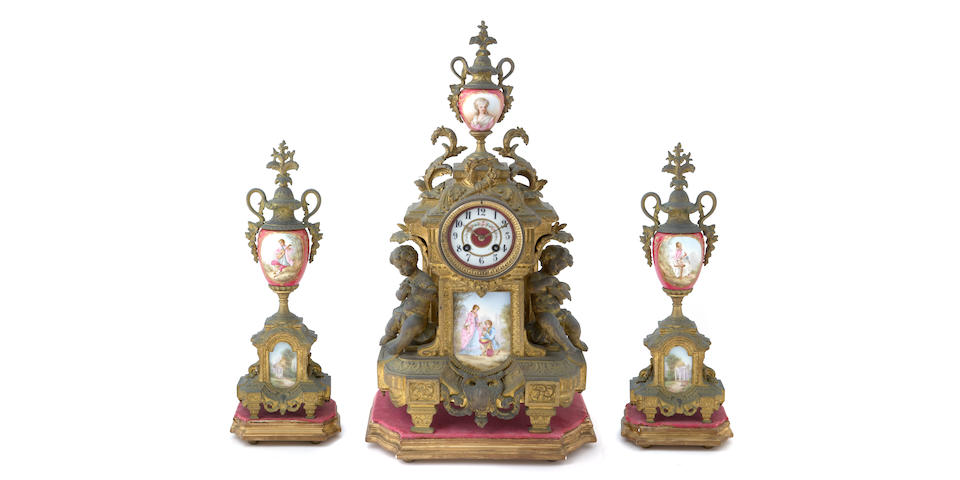 A Continental Sevres style porcelain mounted gilt metal clock garniture