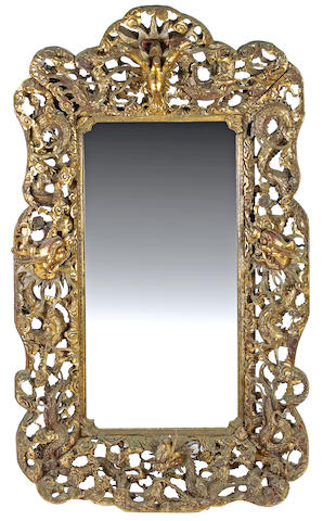 An imposing Chinese carved giltwood mirror
