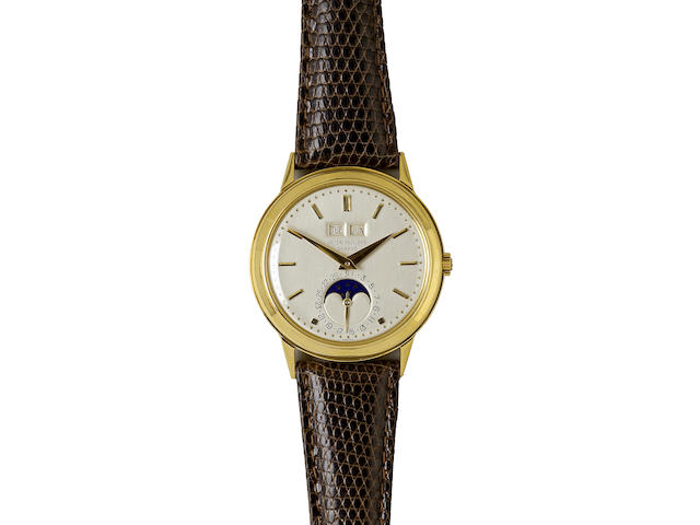 Patek Philippe. An 18K gold automatic wristwatch with perpetual calendarRef. 3448, case no. 320311, movement no. 1119086, retailed by Cartier,