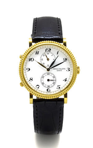 """Patek Philippe. An 18K gold two time zone wristwatch """"Travel Time"""" ref 5034, Case no.     Movement no."""