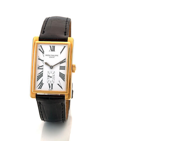Patek Philippe. A fine 18K gold rectangular wristwatch Gondolo, Ref. 5009J-010, movement no. 1860550, sold in 2000