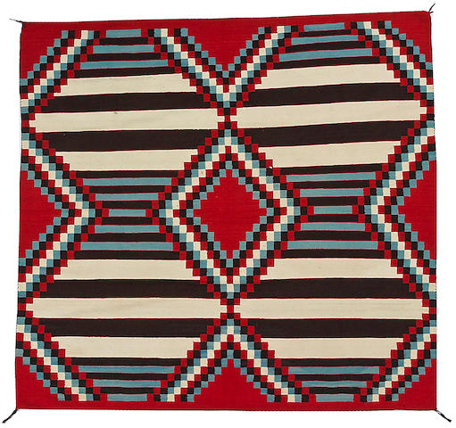 A Navajo chief's design rug, 6ft 2in x 6ft 5in