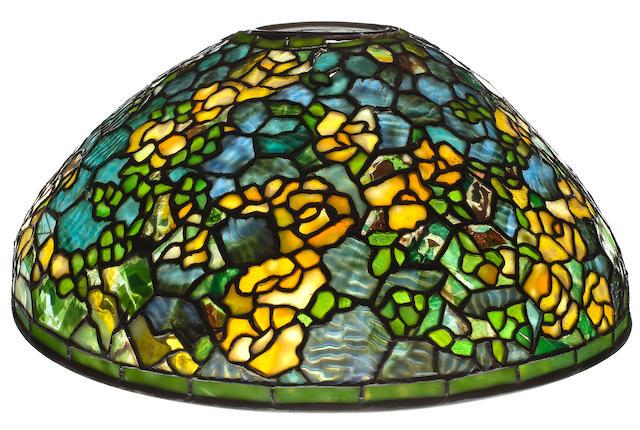 A Tiffany Studios leaded glass and bronze Rambling Rose lamp shade 1899-1918