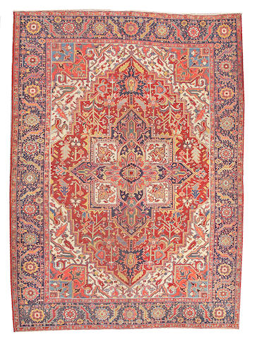 A Heriz carpet Northwest Persia size approximately 8ft. 2in. x 11ft. 4in.