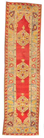 An Oushak runner West Anatolia size approximately 3ft. 5in. x 12ft. 8in.