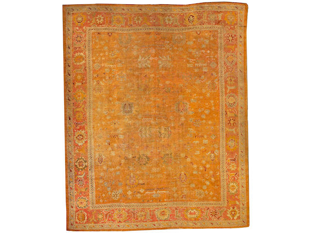 An Oushak carpet West Anatolia size approximately 12ft. 2in. x 15ft. 2in.