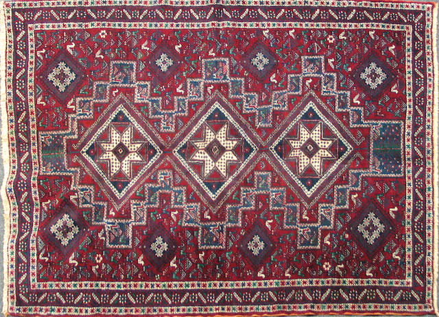 A Southwest Persian carpet size approximately 5ft. 4in. x 6ft. 11in.