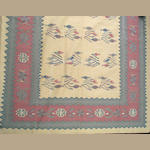A Dhurrie kilim size approximately 8ft. 11in. x 12ft.