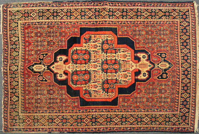 A Senneh rug size approximately 4ft. 4in. x 6ft. 2in.