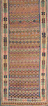 A Kurdish runner  size approximately 2ft. 6in. x 11ft. 11in.