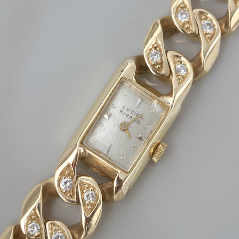 A diamond and 14k gold bracelet wristwatch