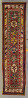 A Gendje runner Caucasus size approximately 2ft. 11in. x 11ft. 4in.