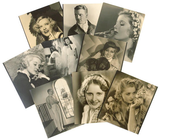 A large collection of sepia and black and white movie star portraits, 1920s-1940s