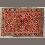 A Heriz carpet Northewest Persia size approximately 10ft. 10in. x 7ft. 4in.