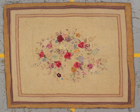 An American Hooked rug size approximately 7ft. 5in. x 6ft. 1in.
