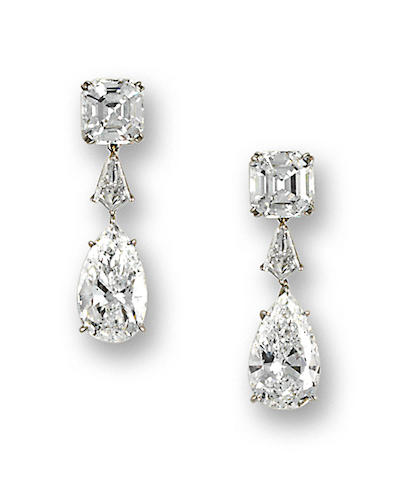 A pair of fine diamond pendant earrings