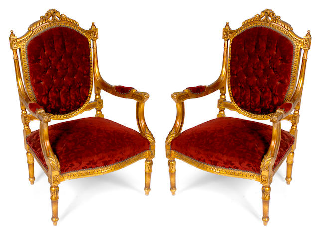 A pair of Louis XVI style red upholstered armchairs