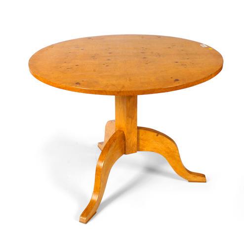 A Beidermeier style maple center table