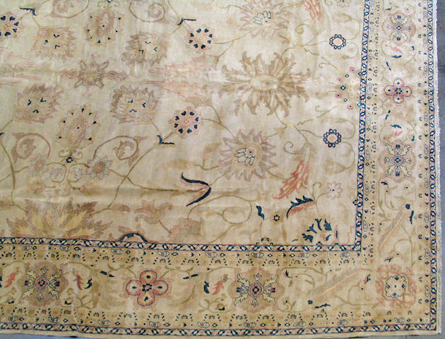 An Egyptian carpet size approximately 12ft. 5in. x 15ft. 9in.