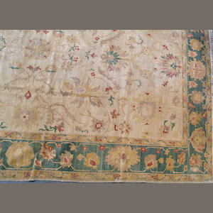 An Egyptian carpet size approximately 12ft. 5in. x 18ft. 7in.