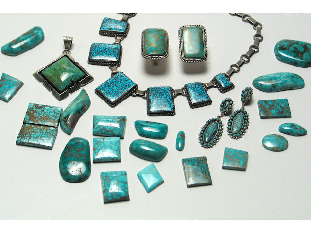 A grouping of Navajo and Zuni turquoise jewelry items and stones
