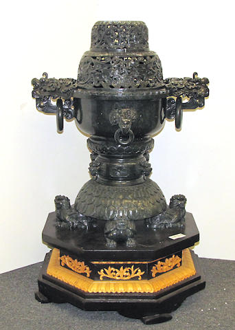 A large Chinese carved deep green hardstone censer on wooden base possibly serpentine