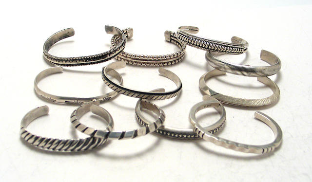 Eleven Southwest silver bangle bracelets