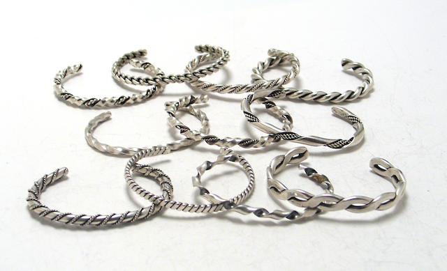 Eleven Southwest silver bangle bracelets