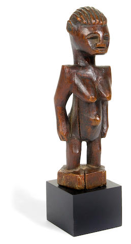 A Senufo female figure, Ivory Coast height 6 1/2in