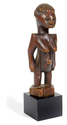 A Senufo female figure, Ivory Coast height 6 1/2in