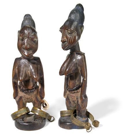 A pair of Yoruba twin figures, ibejis, Nigeria height of largest 10 1/2in