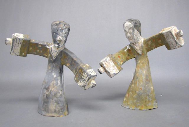A pair of Han style painted pottery models of dancing beauties
