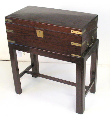An English brass mounted mahogany lap desk on later stand mid 19th century