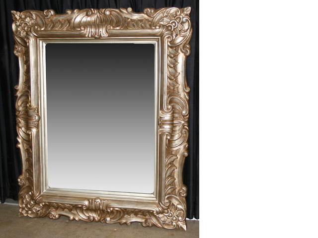 A Rococo style giltwood and  gilt composition mirror