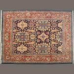 A Sarouk carpet size approximately 6ft. 6in. x 8ft. 5in.