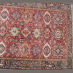 A Karadja carpet size approximately 7ft. 7in. x 11ft.
