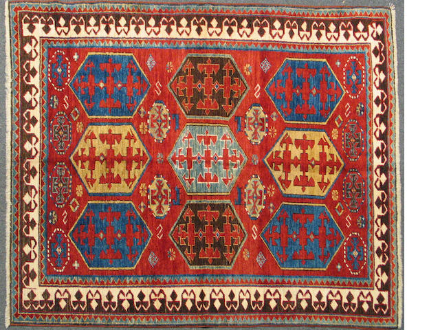 A Kazak rug size approximately 4ft. 10in. x 6ft. 1in.