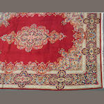 A Kerman carpet size approximately 9ft. 10in. x 13ft. 1in.