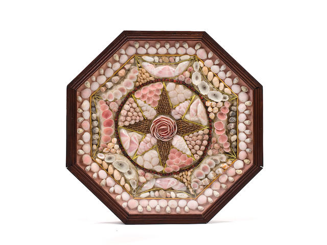 A large 19th century shellwork sailor's valentine 13.1/2 in. (34.3 cm.) diameter.