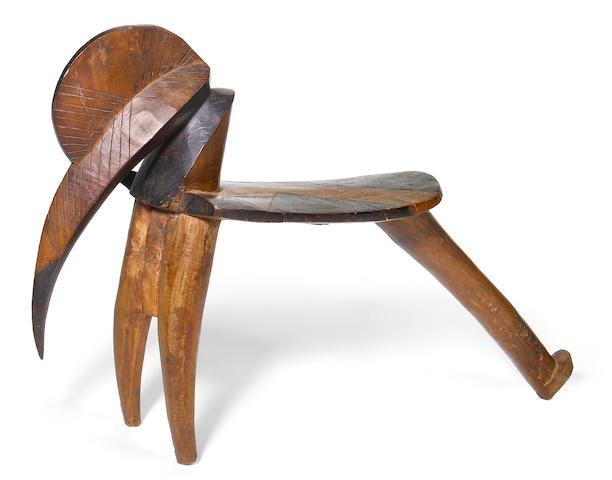 A Lobi stool of bird form height 14 1/4in