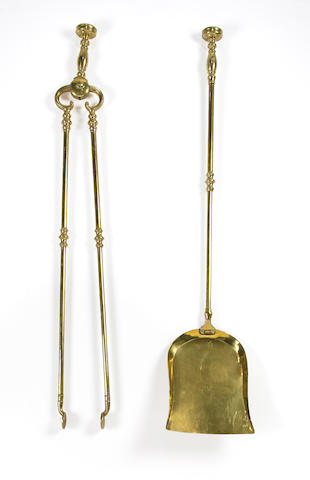 A pair of American brass fire tools decorated with eagles early 19th century