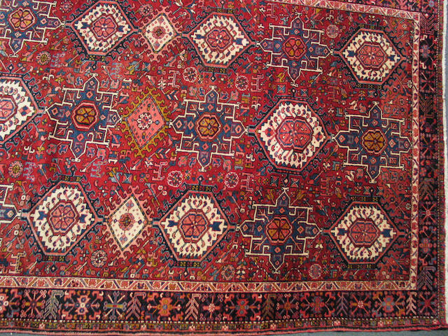 A Heriz Carpet size approximately 12ft. 5in. x 8ft. 10in.